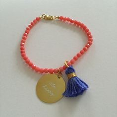 24k gold plated bracelet made with coral stones, embellished with a boho chic tassel and engraved 24k gold tag #be happy http://quiaimelesetoiles.etsy.com