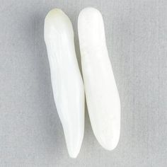 Pair 29+mm Long Baroque Clam Pearls: Type of pearl: Clam Pearls   Weight: 20.70 Carats Total   Shape: Long Baroque   Sizes: 31.5x6mm, 29.5x7mm   Color: White   Location of Origin: Indonesia
