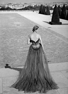 Model in sequined tulle evening gown by Christian Dior photographed by Willy Maywald, Paris, 1950
