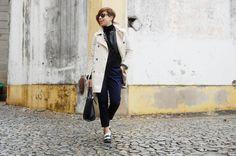 Shop this look on Lookastic:  http://lookastic.com/women/looks/trenchcoat-biker-jacket-turtleneck-dress-pants-platform-loafers-tote-bag-sunglasses/8299  — Beige Trenchcoat  — Black Leather Biker Jacket  — Black Turtleneck  — Navy Dress Pants  — White and Black Leather Platform Loafers  — Black Leather Tote Bag  — Black Sunglasses