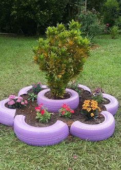 If you have old car tires hanging around in the garage put them to work growing vegetables. Remove the center hub and just use the rubber tire itself. The tires make handy plant containers and are easy to place out in the garden. Use a single tire. Tire Garden, Bottle Garden, Garden Yard Ideas, Diy Garden Projects, Garden Crafts, Diy Garden Decor, Garden Pots, Potager Garden, Rock Garden Design