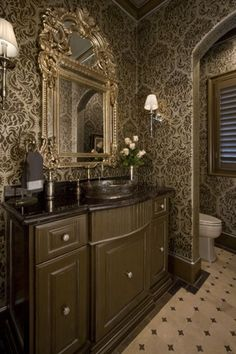 Traditional Powder Room with limestone tile floors, Gold wallpaper, Soapstone counters, Vessel sink, Flush, Wall sconce
