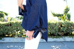 Bows and bell sleeves.