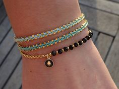 Items similar to Black and Gold Bracelet - Hamsa Charm Bracelet on Etsy - Bracelets Diy Jewelry, Beaded Jewelry, Jewelery, Jewelry Bracelets, Handmade Jewelry, Jewelry Gifts, Fashion Jewelry, Charm Armband, Gold Armband