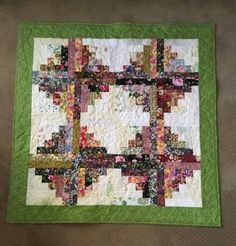 Scrappy floral log cabin shared on MyQuiltPlace by Ethelda Hillsman
