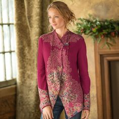 """VASSILISA CARDIGAN--Our cardigan's intricate patterning has roots in Serbian folkloric motifs—it was designed and knit in Belgrade of extra-fine Italian merino wool. Cut with an easy flare, it closes with a decorative button and hidden snaps. Hand wash. Sizes S (2), M (4 to 6), L (8 to 10), XL (12 to 14). Approx. 28""""L."""