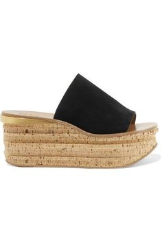"""Chloe's 'Camille' sandals are a style you'll find yourself wearing time and again throughout the summer - """"the laid-back attitude and easy slip-on fit hint at long, balmy days by the coast,"""" says the brand. Made in Italy from supple black suede, they're set on a cork wedge with a gold spur at the heel. Wear yours with everything from dresses to denim."""