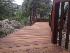 Restored deck with eco-friendly Boodge decking stain in Dark Cedar color.