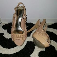 Bebe Spike Peep Toe Sling back pumps Bebe spike peep toe sling back pumps.   Worn once, no scuffs! Only visible signs of wear is on the bottom.   Like new. Size 7. Color is patent nude. Heel height about 4 inch. With platform bed.  No box, no trades, thank you :) bebe Shoes Heels