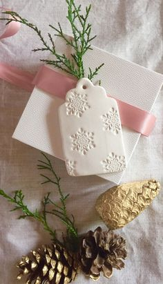 These are special 2015 Christmas Embossed Snowflake Gift Tags, lovingly handmade…perfect to tie onto gifts for colleagues, friends and family.