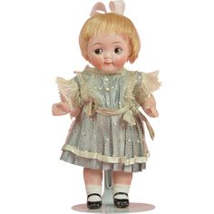 Cute All Bisque Kestner Googly - 6.5 Inches tall $550 USD OFFER. Beautiful dress and terrific painted and molded maryjanes.