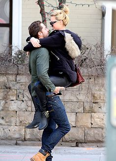 Margot Robbie jumped into boyfriend Tom Ackerley's arms during an affectionate outing in Toronto April 11.