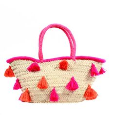 Beautifully crafted of palm leaf and showcasing charming cotton tassels, this lovely tote bag is perfect for a trip to the local farmer's market or an aftern...