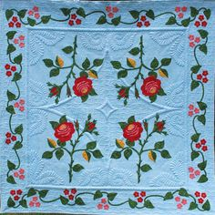 """Bed of Roses"", a remake of the Moss Rose Quilt (1853 Susan Black Stayman). 2011 PSL Crazy Quilters Raffle quilt. Trapunto and machine quilting by  Karen Marchetti."