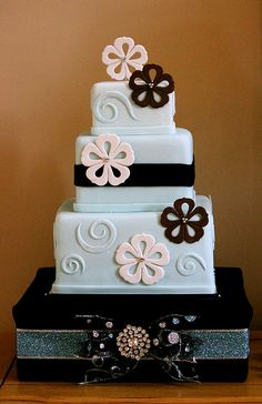 cute blue cake with black and white flowers