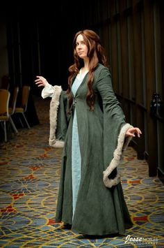 Kat: It's an light weight underdress, a heavy over dress, and a jacket. We can always put a cloak over that if you're still cold, or if you're hot you can take off the jacket.