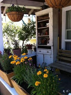 Spring poirch with hanging baskets and flower-boxes