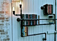 Wonderful super easy idea for shelves using gas pipes - love the added electrical element super easy to wire to a plug. Stealing this!