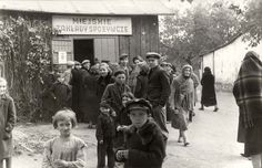 Warsaw, Poland, October 1939, People waiting in line at a food distribution station.