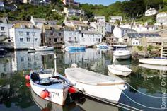 Polperro, a spectacular few miles along the coast from Looe, is a different kettle of fish. Sheltered from the ravages of time and tide in its cliff ravine, it's an enchanting jumble of cottages, each one unmistakably the work of a Cornish fisherman.