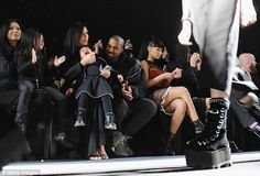 Tough times: Kanye tried comforting his adorable child as she squirmed and bawled during t...
