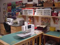 sewing room. I love the two sewing machines with their own space, and the wall of thread in all the colors of a rainbow...