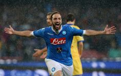 Gonzalo Higuain of Napoli celebrates after scoring his team's 4th goal during the Serie A match between SSC Napoli and Frosinone Calcio at Stadio San Paolo on May 14, 2016 in Naples, Italy.