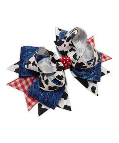 A little lady can never have too many bows. Add one more with this playfully layered piece. Classic gingham blends effortlessly with a punchy cow print to create a piece sure to standout in any accessory collection.