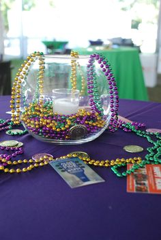 Use Mardi Gras beads to create a simple centerpiece. I wonder if they would sink or float in water.
