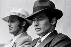 French actors Jean-Paul Belmondo and Alain Delon on the set of gangster movie Borsalino, directed by Jacques Deray in Paris, France, in September Get premium, high resolution news photos at Getty Images Alain Delon, Frances Movie, Gangster Movies, French Man, Famous French, The New Wave, Black Mask, Old Movies, Photojournalism