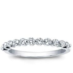 Love this gorgeous shared prong diamond wedding band! You can barely see any metal