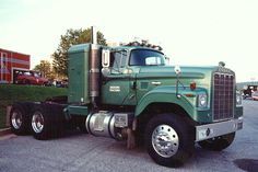 This truck was originally sold here in York, PA at D.E. Stetler Dodge. It had been built and was in a pool of trucks in the mid-west. The sleeper was added immediately. This shot was taken in 1987 at the ATHS show in Baltimore, MD.