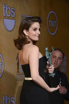 """Tina Fey poses with her trophy for outstanding performance by a female actor in a comedy series for her work on """"30 Rock,"""" which airs its series finale Thursday. (Photo: Frazer Harrison / Getty Images) #SAGAwards"""