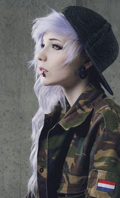 Pretty hair and piercings ^-^ she kinda looks like a female Andy biersack wut O.oo