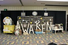 Stage Decor, everyday items + large letters + wooden slats and flags.