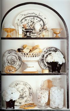 bathroom toiletries arranged on shelves in the book Black & White by Celerie Kemble; pg. 171