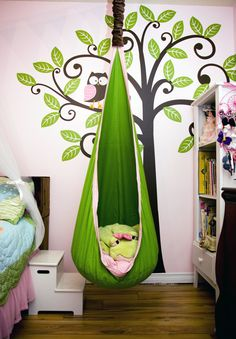 Reading nook area in my girls' room. The just love this pod swing! by hilda. stylized tree is playful