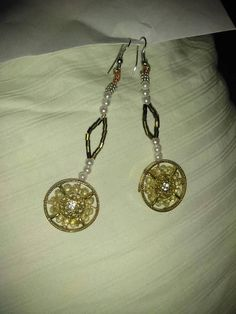 Made from mandala inspired circles, these gold circle clock style earrings are to die for. They swing like a pendulum upon wearing them and shine With the intricate upwrap Beading, from bottom to top, these pendlums will keep step with you. Etsy Earrings, My Etsy Shop, Clock, Beads, Gold, How To Wear, Style, Watch, Beading