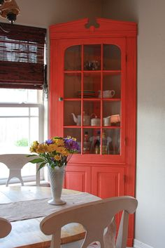 china cabinet makeover - bright poppy painted corner cabinet.      We have the exact same cabinet!!