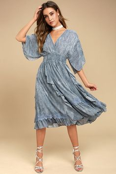 Every movement in the Moon River Volga Slate Blue Midi Dress will be filled with grace and beauty! Slate blue woven poly sweeps across a lace trimmed, surplice neckline, with half sleeves, and a tying, open back. Smocked waist tops a midi skirt with ruffled panels, and a crochet lace hem.