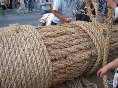 Naha Tug of War    CONTRIBUTED BY HEATHER NORDELL   I want you to close your eyes and imagine the world's largest tug of war. Imagine a rope so large that they have close down route 58 to have enough room to lay it down. Picture hundreds of hand ropes hanging from the mas ...