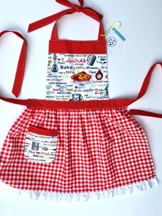 Adult and Child apron set is perfect for the family who likes to spend time together in the kitchen. Create tasty treats and sweet memories while wearing these retro country inspired aprons that feature a baking print and red and white gingham. Adult O/S Child size fits about age