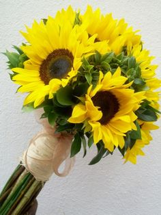 Big, beautiful sunflowers delicately wrapped in tree bark. Such a cute idea!