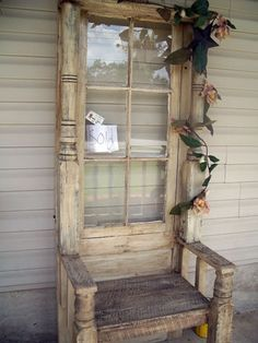 This inspiring chair is made out of old windows and porch posts! I see old furniture like this at flea markets and salvage yards. Garage and Estate sales are cool places to find items like this too that you can be creative with. #repurposedfurniturechair