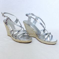 """Strappy Silver Wedges Beautiful Silver Strappy Wedges with Rope Covered 4"""" Heel and 3/4"""" Platform.  New and NEVER WORN but left shoe has a small scuff at front of sole. Forever 21 Shoes Wedges"""