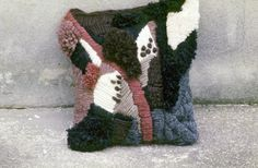 Woods and nature expressed in a needlework pillow