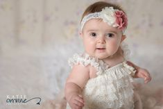Best and cute 6 Month Milestone Portraits.  Baby girl in white ruffled romper and flower headband.  Adorable.  Photography by Katie Corinne Photography Brynlee was so delightful for her 6 month milestone session! I seriously could not get enough of that baby chunk and all her fun expressions!
