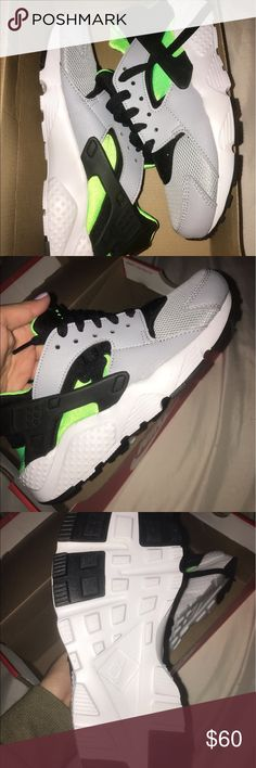 NIKE HUARACHE RUN Grey, black, white, and green Nike Huaraches. Brand new never worn before. It's a size 5 in kids and it fits me great and I'm a size 6.5-7 in women. I'm trying to get rid of these asap because they're just sitting in my closet! Any questions feel free to ask :) Nike Shoes Sneakers