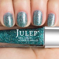 Get mermaid nails with Julep Taryn (a deep sea teal holographic glitter)