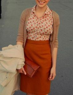 Veering towards frumpy with the cardigan, but like the deep orange wool skirt and floral blouse.